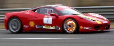glowing Ferrari brake pads on the track