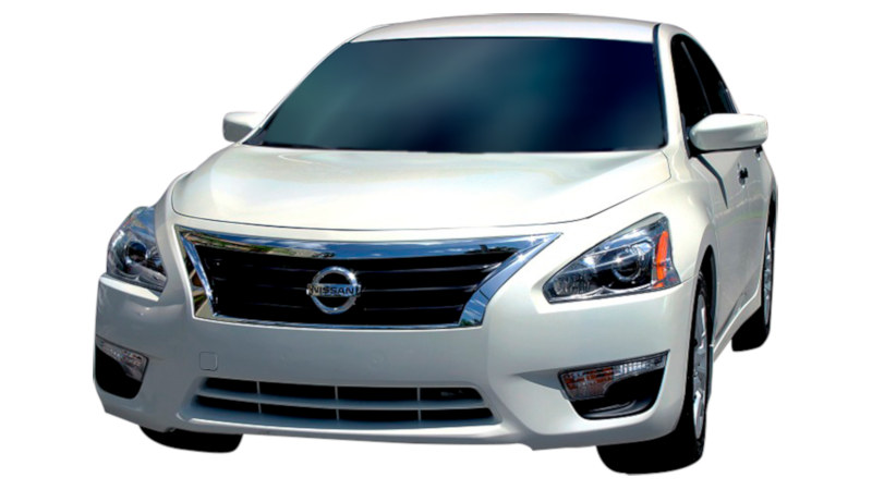 White Nissan Altima front end